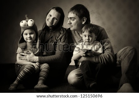 portrait of a family of four, mom dad daughter and son, with young children - stock photo