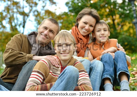 Portrait of a family resting in park