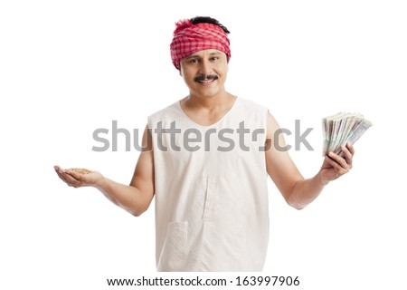 Portrait of a farmer holding money in one hand and wheat in another hand - stock photo