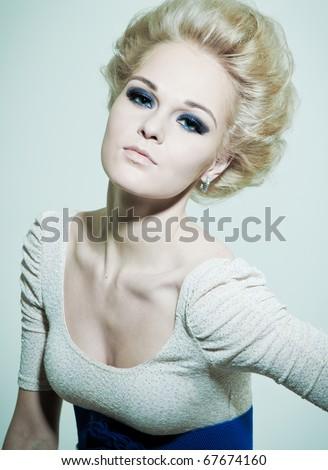 Portrait of a fashion blonde with dark eyes - stock photo