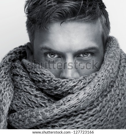 Portrait of a fashion models face covered by scarf - black and white - stock photo