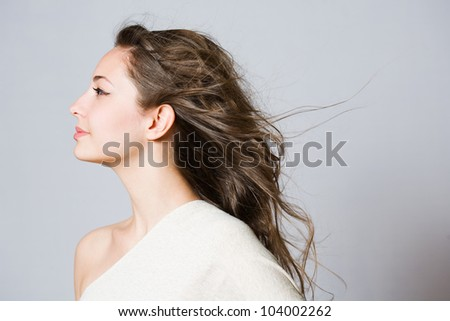 Portrait of a fashionable dreamy young brunette beauty. - stock photo