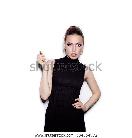 Portrait of a fashionable female model with a cigarette holder. Perfect skin. Retro style. Studio shot on white background not isolated - stock photo