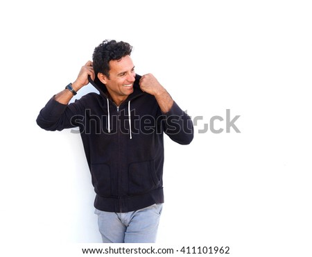 Portrait of a fashionable middle aged guy laughing against white background - stock photo