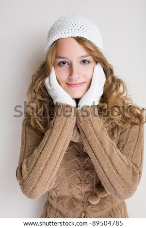 Portrait of a fashionable young woman in winter outfit.
