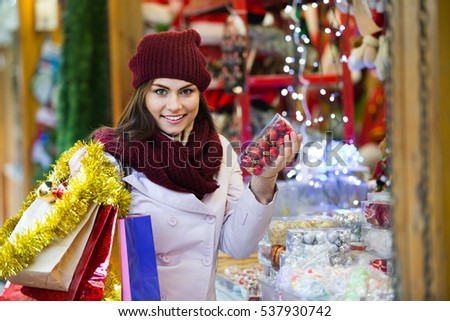 Portrait of a female customer near counter with Christmas gifts