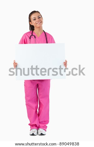 Portrait of a female doctor holding a blank panel against a white background