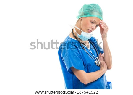 Portrait of a female doctor/surgeon feeling down, exhausted, frustrated, very tired, .... on white background - stock photo