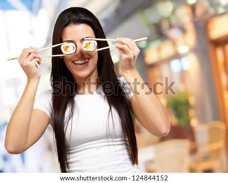 Portrait Of A Female Holding Sushi Roll, Background - stock photo