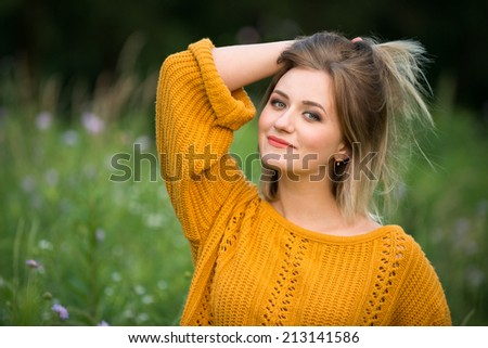 portrait of a female in nature - stock photo