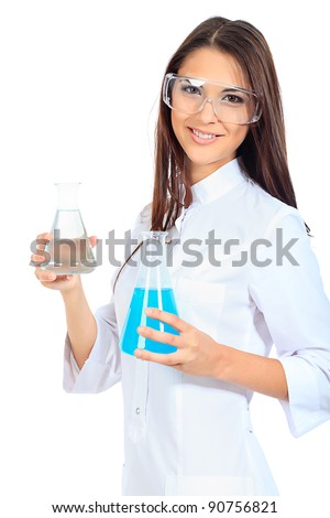 Portrait of a female laboratory assistant holding flasks. Isolated over white. - stock photo