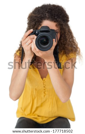 Portrait of a female photographer over white background - stock photo