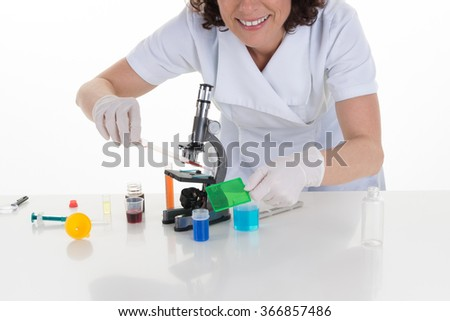 Portrait of a female researcher doing research in a lab - stock photo