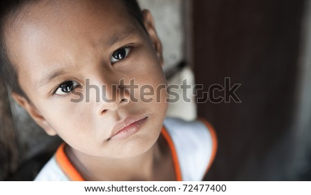Portrait of a Filipino boy living in poverty - natural light - Manila, Philippines - stock photo