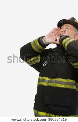 Portrait of a firefighter shouting - stock photo