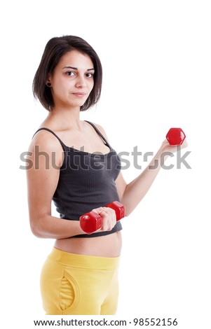 Portrait of a fit young lady working out with dumbells against white background