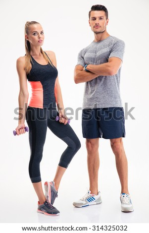 Portrait of a fitness couple standing isolated on a white background - stock photo
