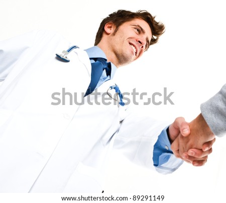 Portrait of a friendly doctor introducing himself to a patient - stock photo