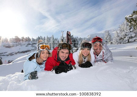 Portrait of a friends on a skiing holiday together - stock photo