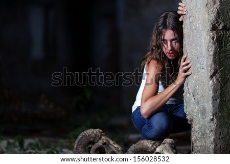Portrait of a frightened girl - stock photo