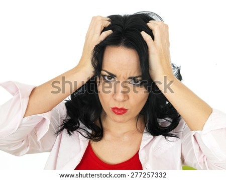Portrait of a Frustrated Beautiful Young Hispanic Woman in Her Twenties Pulling Her Hair in Disbelief - stock photo