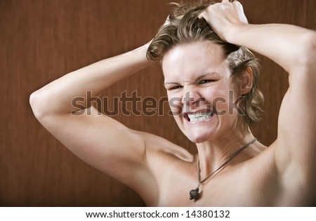 Portrait of a frustrated woman pulling her hair - stock photo