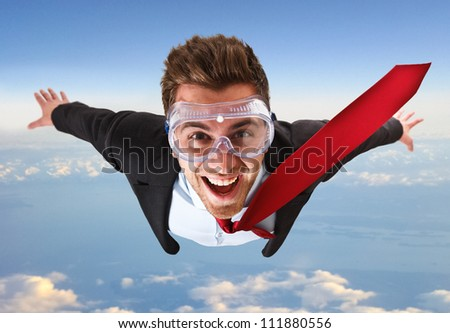 Portrait of a funny businessman skydiving - stock photo