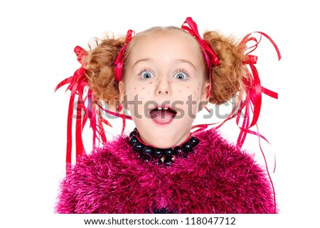 Portrait of a funny emotional girl with festive make-up, hairstyle and dress.