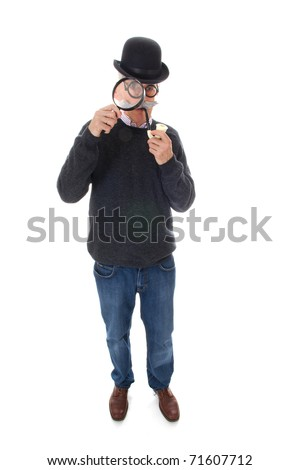 Portrait of a funny inspector with a big magnifier for investigation - stock photo