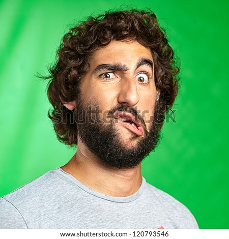 Portrait Of A Funny Man On Green Background