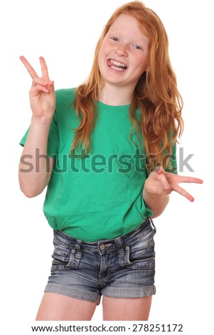 Portrait of a funny teenage girl showing victory sign on white background - stock photo