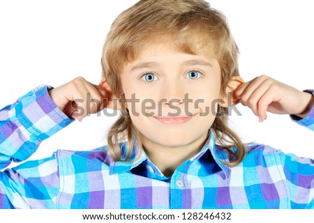 Portrait of a funny 9 year boy holding his ears. Isolated over white background. - stock photo