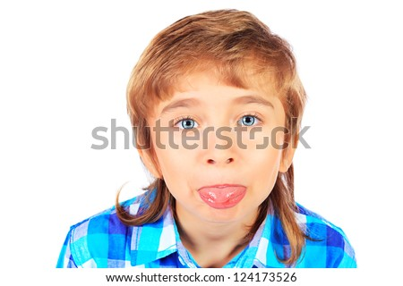 Portrait of a funny 9 year boy puting out his tongue. Isolated over white background. - stock photo