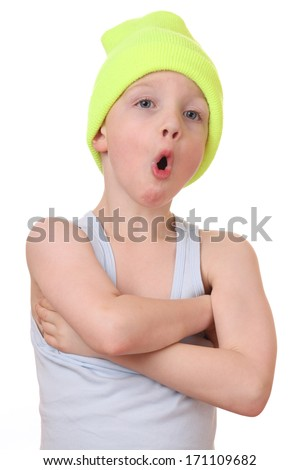 Portrait of a funny young boy on white background - stock photo