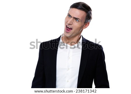 Portrait of a funny young businessman with mouth open - stock photo