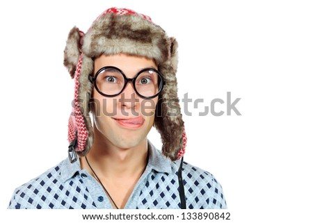Portrait of a funny young man in big round spectacles and winter hat. Isolated over white background. - stock photo