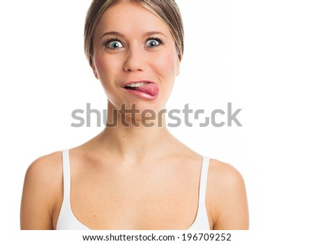 Portrait of a funny young woman sticking tongue out - stock photo