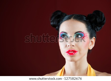 Portrait of a funny young woman with colorful makeup, closeup shot