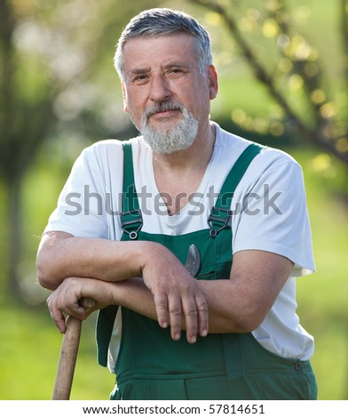 Portrait of a gardener in a garden - stock photo