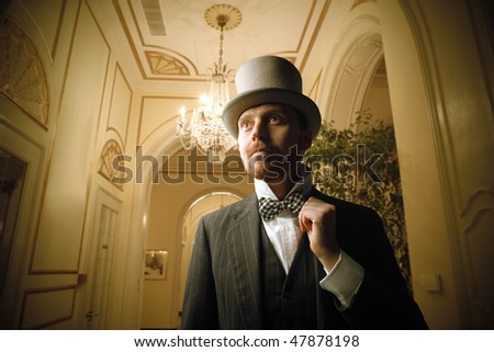 Portrait of a gentleman standing in a hall of a luxury hotel - stock photo