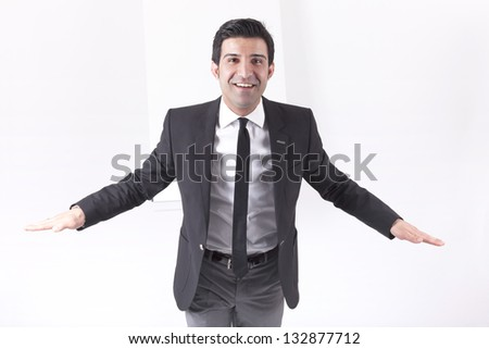 portrait of a gesticulating executive during business meeting and coaching. Studio shot with a flipchart on a white background. - stock photo