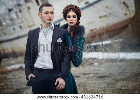 Portrait of a girl and a guy, the bride and groom in love couple on the dock. Love, relationships, style, fashion, portrait. - stock photo