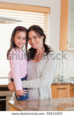 Portrait of a girl and her mother in a kitchen