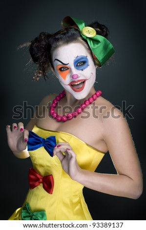 portrait of a girl clown with painted face. - stock photo
