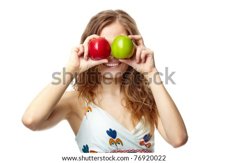 Portrait of a girl covering her eyes with apples - stock photo