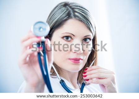Portrait of a girl doctor - stock photo