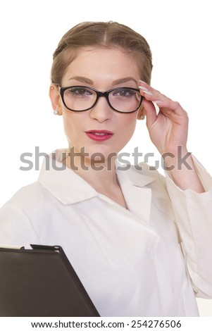 portrait of a girl doctor with glasses and folder in hands on white. Soft focus. - stock photo