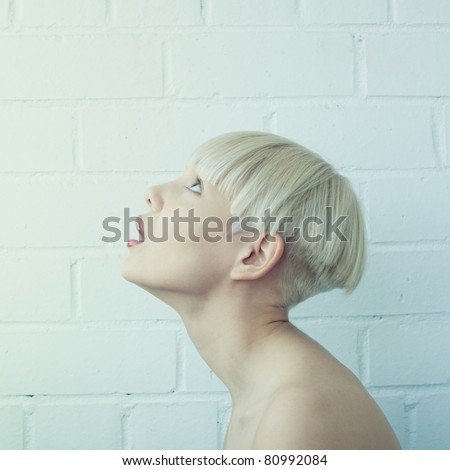 portrait of a girl facing upward - stock photo