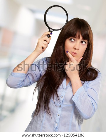 Portrait Of A Girl Holding A Magnifying Glass And Thinking, Indoor