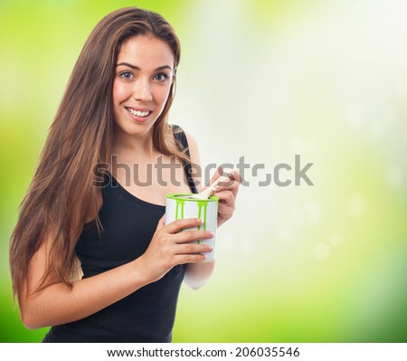 portrait of a girl holding a paint can - stock photo